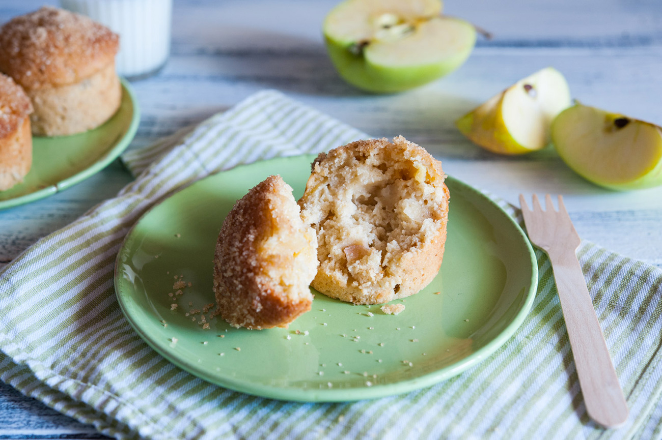 Apple muffin on a white back ground with strip green white towels and wood fork