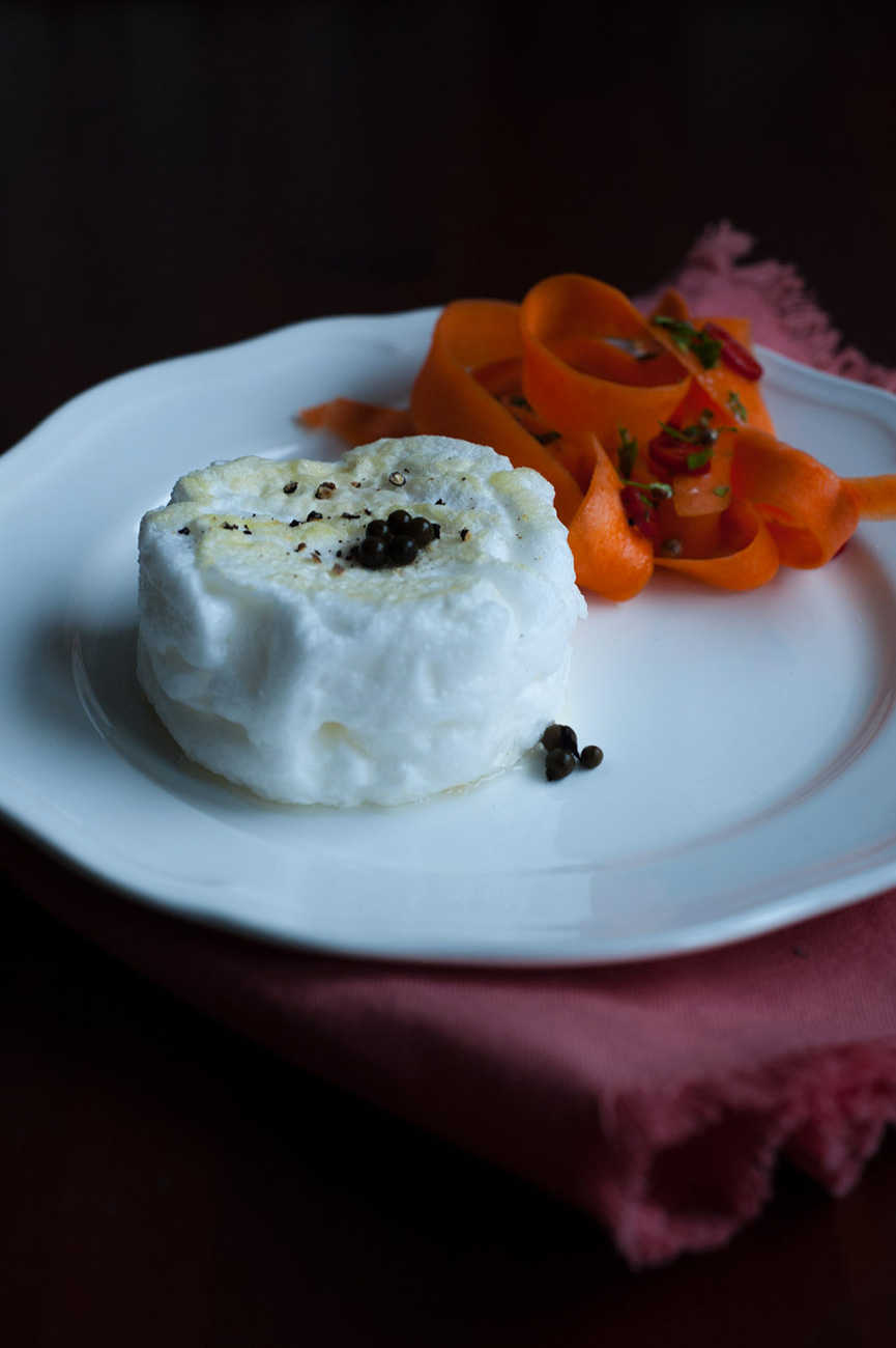 Poached egg with grain pepper and dressed carrots with fresh red hot chili pepper
